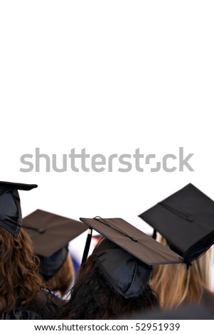A group of college or high school graduates wearing the traditional cap and gown isolated over white.  Plenty of copy space for your text or layout.  Shallow depth of field. - stock photo