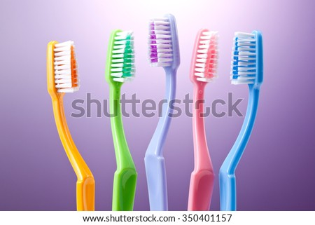 a group of colorful toothbrushes - stock photo