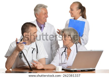 A group of doctors discussing at the table - stock photo