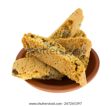 A group of four slices of Cantuccini biscuits with chocolate chips in a small ceramic bowl. - stock photo