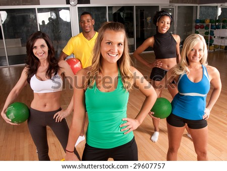 a group of friends in a fitness class using medicine balls - stock photo