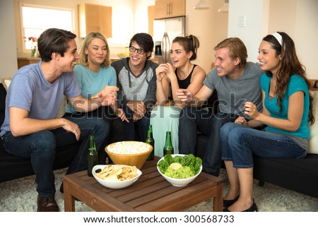 A group of friends in conversation talking storytelling gossiping chatting laughing revisiting reunion - stock photo