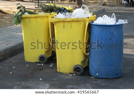 A group of Garbage cans on the side of the road - stock photo