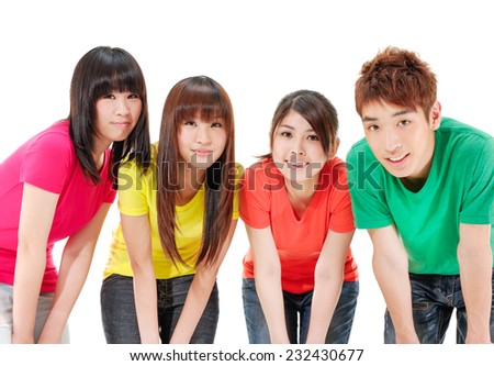 A group of happy friends standing casually together. - stock photo