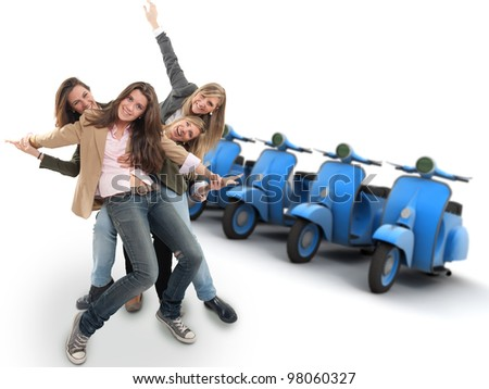 A group of happy girls and a line of scooters - stock photo