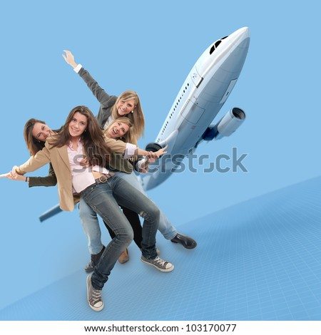 A group of happy girls celebrating an airplane travel - stock photo