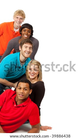 A group of happy multi-racial college students/friends on a white background - stock photo