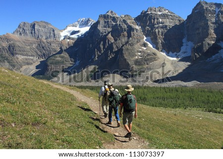 A group of hikers near Moraine Lake in Banff National Park - stock photo