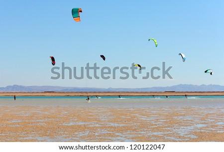 a group of kite surfers, Dahab, Egypt - stock photo