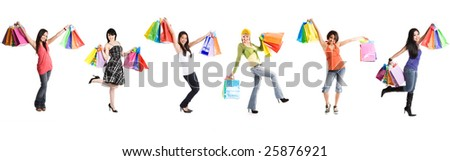A group of multi ethnic women carrying shopping bags - stock photo