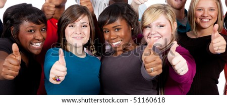 A group of multi-racial college students/friends holding their thumbs up - stock photo