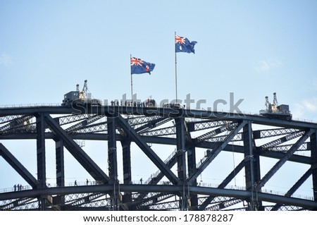 A group of people at the top of the Sydney harbour bridge - stock photo