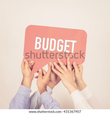 A group of people holding the Budget written speech bubble - stock photo