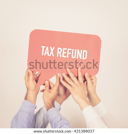A group of people holding the Tax Refund written speech bubble - stock photo