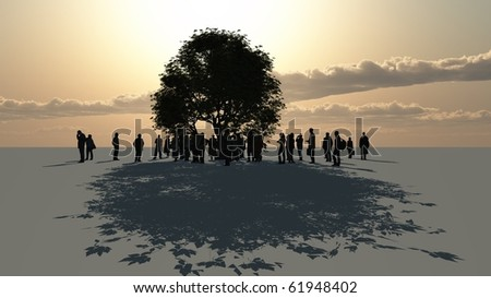 a group of people standing around a tree - stock photo