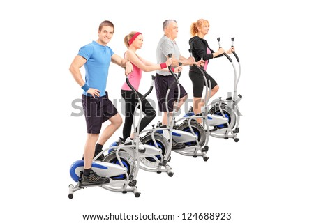 A group of people working on a cross trainer machine isolated against white background - stock photo