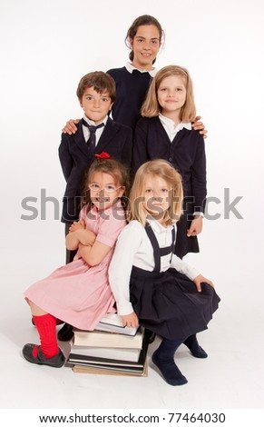 A group of 5 schoolchildren of different ages - stock photo