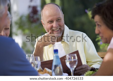 A group of senior couples at a restaurant - stock photo
