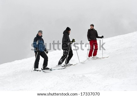A group of skiers on the snow - stock photo