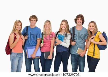 A group of smiling students with the school gear - stock photo