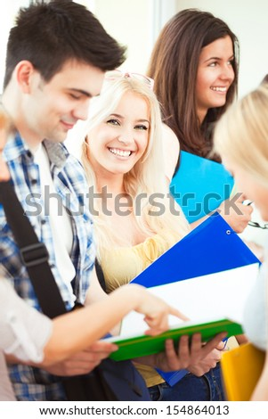 A group of students during a break between classes. - stock photo