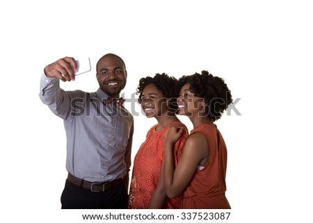 A group of teens taking a picture of themselves on a cell phone - stock photo