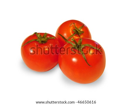 A group of three tomatoes and a light background - stock photo