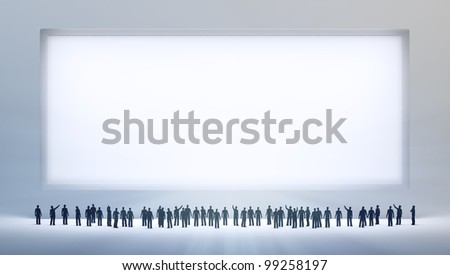 A group of tiny people looking at an empty ad board or painting - stock photo