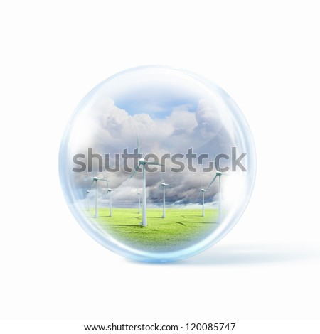A group of wind turbines or windmills inside a glass sphere - stock photo