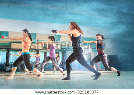 a group of women in sport dress at boxing exercise - stock photo