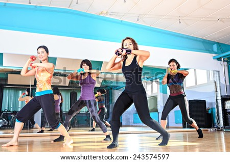 a group of women in sport dress at piloxing exercise - stock photo