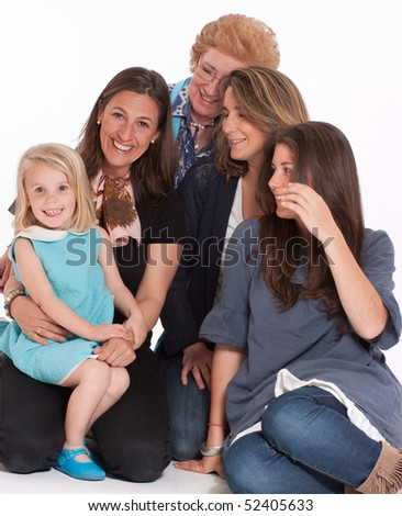 A group of women of different ages posing happily - stock photo