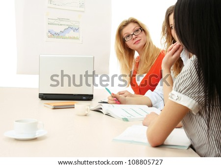 A group of working women is sitting on the table - on white background - stock photo