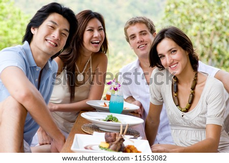 A group of young adults having lunch on vacation - stock photo