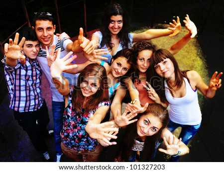 A group of young people dancing at a disco. - stock photo