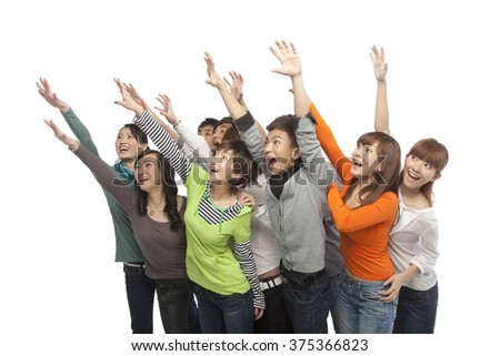 A group of young people looking up in excitement - stock photo