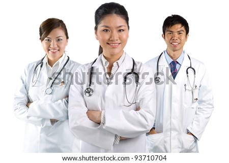 A group Portrait of an Asian medical team, isolated on white. - stock photo