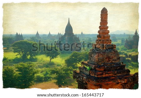 A grunge texture gives a vintage look at the famous pagoda's in the Valley of Bagan in Myanmar , Asia - stock photo