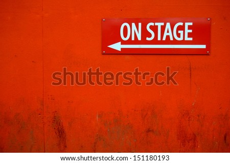 A Grungy 'On Stage' Sign Outside A Theatre Door - stock photo