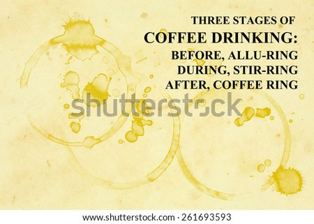 """A grungy paper napkin with coffee mug stains and a funny quote """"Three stages of coffee drinking: Before: Alluring, During: Stirring, After: Coffee Ring"""". - stock photo"""