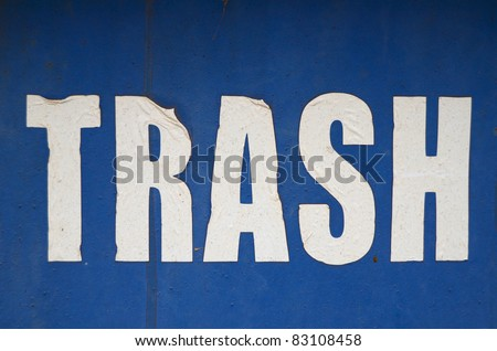A Grungy, Weathered Trash Sign On A Blue Background - stock photo