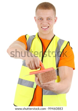 A guy holding a brick and a trowel. Isolated on white - stock photo