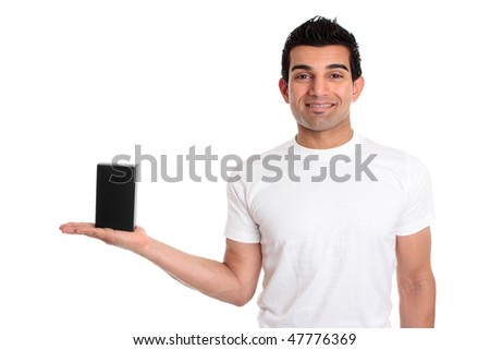 A guy marketing or showing your packaged product.  He is wearing a white t-shirt and smiling - stock photo