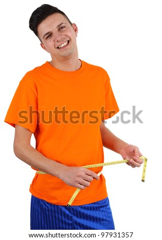 A guy measuring his waist, isolated on white - stock photo