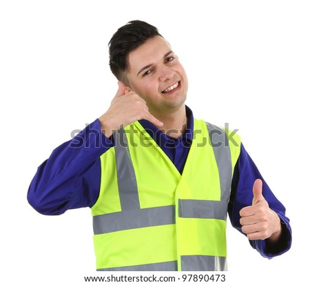 A guy pretending to talk on the phone with a thumbs up sign - stock photo