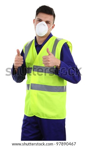 A guy wearing a dust mask with a thumbs up sign - stock photo