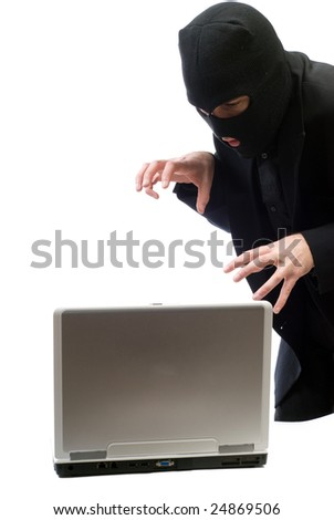A hacker about to break into a portable computer, isolated against a white background - stock photo