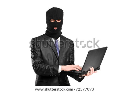 A hacker working on a laptop isolated against white background - stock photo