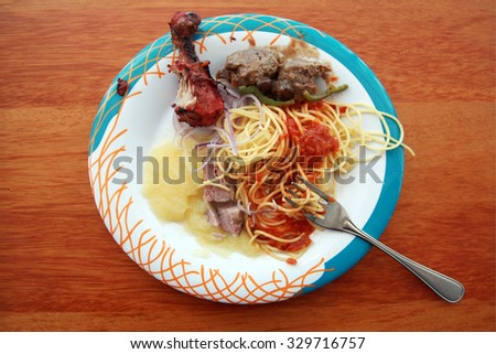 a half eaten plate of food. Everyone's got to eat. - stock photo
