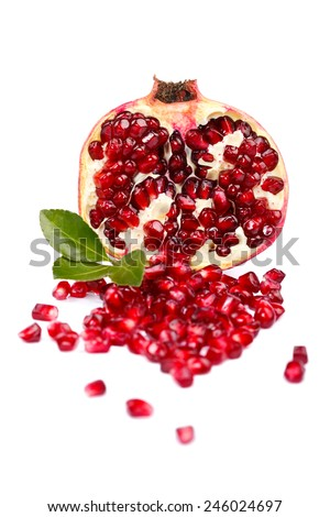 A half grenadine with seeds over white background - stock photo